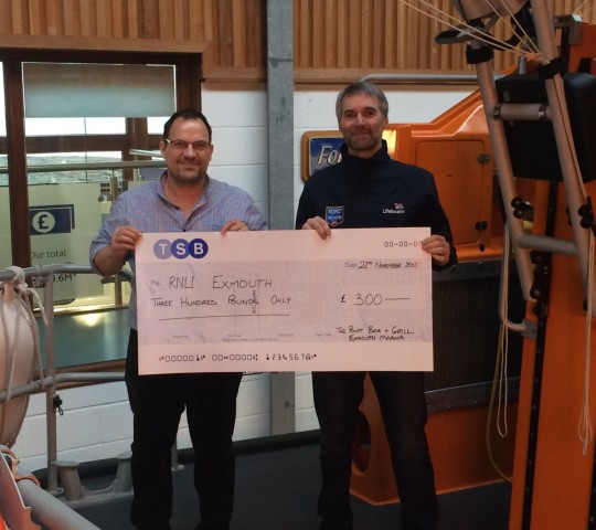 Richard presenting the cheque to steve